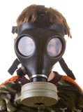 Boy in a gas mask. Isolated on white background Royalty Free Stock Photography