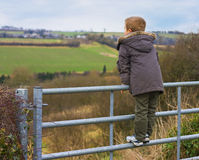 Boy on gate Royalty Free Stock Images