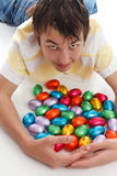 Boy gathering together easter eggs Royalty Free Stock Photo