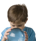 Boy Gazes into a Crystal Ball Royalty Free Stock Photo
