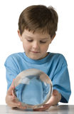 Boy Gazes into a Crystal Ball Royalty Free Stock Photos