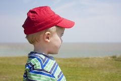 Boy gazing out to sea Royalty Free Stock Photography