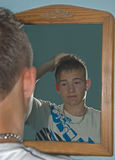 Boy Gelling Hair Royalty Free Stock Image