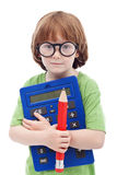Boy genius. Concept - child with large glasses, pencil and calculator Stock Photos