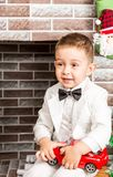 Boy gentleman by fireplace. Christmas, New Year royalty free stock photo