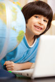 Boy on a geography lesson Royalty Free Stock Photography