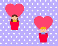 Boy and gerl sitting in hot air balloon in the shape of heart  Royalty Free Stock Photos