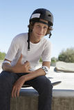 Boy Gesturing Shaka Sign In Skate Park Stock Photos