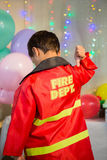 Boy gesturing to the text on protective workwear Royalty Free Stock Images