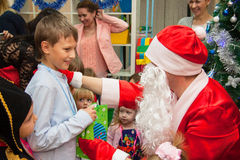 Boy gets presents from Santa Stock Images