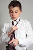 Boy getting dressed for school Stock Image