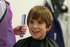Boy Getting a Haircut Stock Photos