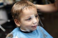 Boy getting haircut Stock Photo