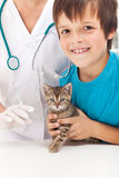 Boy getting his kitten to vaccination Royalty Free Stock Photo