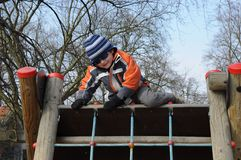 Boy getting over barrier Royalty Free Stock Images