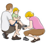 Boy Getting Shoes Tied Royalty Free Stock Images