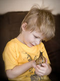 Boy and Giant African landsnail Royalty Free Stock Image