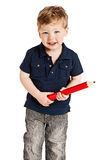 Boy with Giant Pencil. Cute boy holding a big pencil looking happy on a studio white background Stock Photos