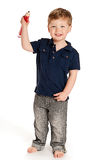 Boy with Giant Pencil. Cute boy holding a big pencil looking happy on a studio white background Stock Images