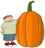 Boy With A Giant Pumpkin Royalty Free Stock Image