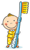 Boy with a giant toothbrush Royalty Free Stock Photos