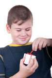 Boy with  gift. On white background Royalty Free Stock Photography