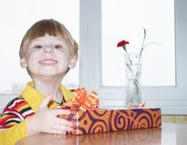 The boy with a gift Royalty Free Stock Photos