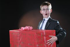 Boy and gift Royalty Free Stock Image