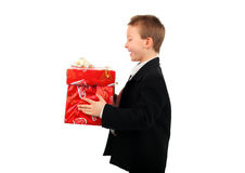Boy with gift. Happy boy with a gift isolated on the white background Royalty Free Stock Photography