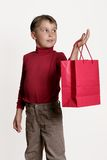 Boy with gift bag Royalty Free Stock Photo