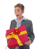 Boy with a gift box and a flower Royalty Free Stock Photo