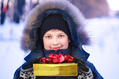 Boy with gift box outdoors Stock Photography
