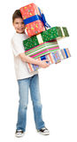 Boy with gift boxes Stock Photos