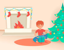 Boy with gift. Christmas or New Year. Near the decorated tree and fireplace. Vector illustration. Cute cartoon stylized child Stock Photos