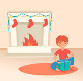 Boy with gift. Christmas or New Year. Near the fireplace. Vector illustration. Cute cartoon stylized child Royalty Free Stock Photos