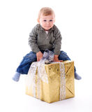 Boy with gift isolated Stock Images