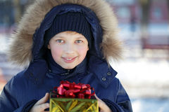 Boy with gift outdoors Stock Photo