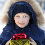 Boy with gift outdoors. Happy boy with gift outdoors Royalty Free Stock Photos