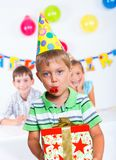 Boy with giftbox at birthday party Royalty Free Stock Image