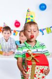 Boy with giftbox at birthday party Royalty Free Stock Photos
