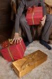 Boy with giftboxes Royalty Free Stock Photos