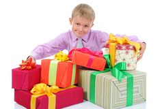 Boy with gifts Stock Photography