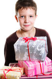 Boy with gifts Royalty Free Stock Image