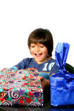 Boy with gifts. Digital photo of a little boy  unwrap his gifts Stock Images