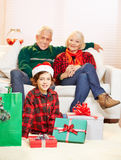 Boy with gifts at christmas Stock Image