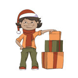 Boy And Gifts. Cute Boy In The Scarf And Christmas Hat Standing Above Gifts Royalty Free Stock Photo