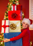 Boy with gifts Royalty Free Stock Photography