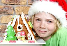 Boy and gingerbread house Royalty Free Stock Image