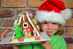 Boy and gingerbread house Stock Image