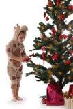 Boy in giraffe costume near Christmas tree. Isolated on white royalty free stock photos